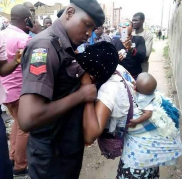 BUT WHY! Policemen Beat Nursing Mother To Stupour, Drag Her On The Floor For Asking To See The DPO