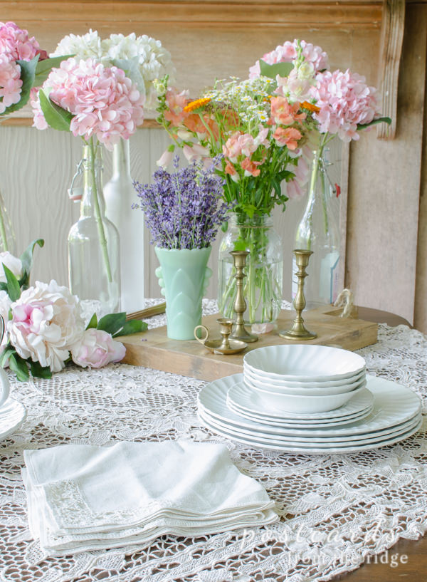 vintage lace linens and flowers on a summer dining table