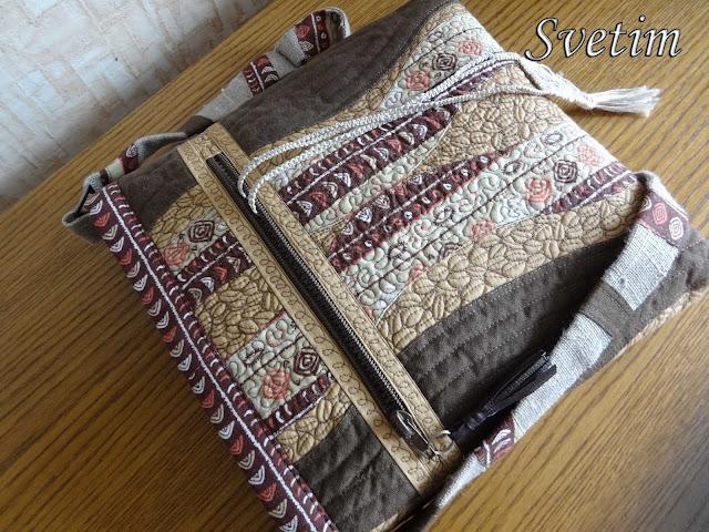 красивая стеганная сумочка на ремне коричневого цвета