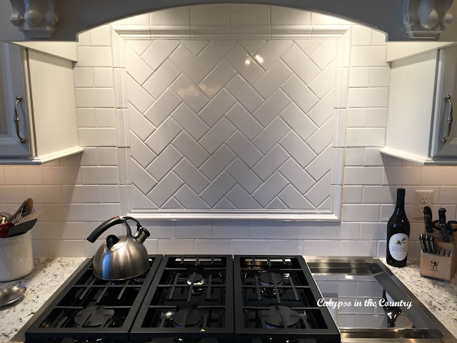 Subway Tile Backsplash with Herringbone Design
