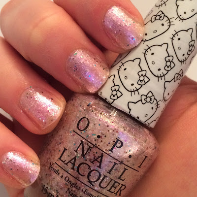 opi hello kitty swatch and review charmmy and sugar