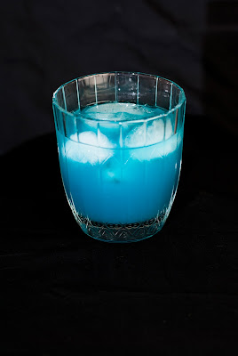 into the blue cocktail, light rum, blue curacao, grapefruit juice, club soda