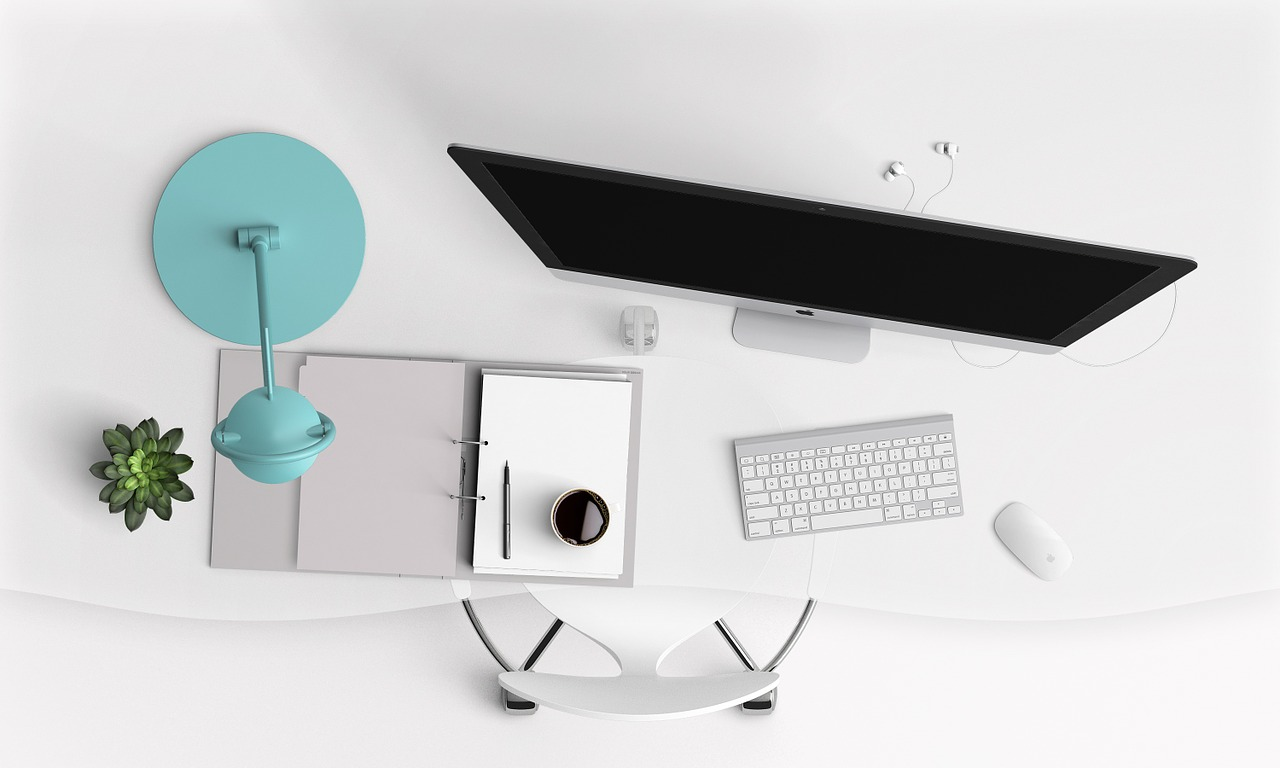 Stock photo from pixabay of a computer desk with a laptop