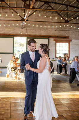 bride and groom first dance with market lighting
