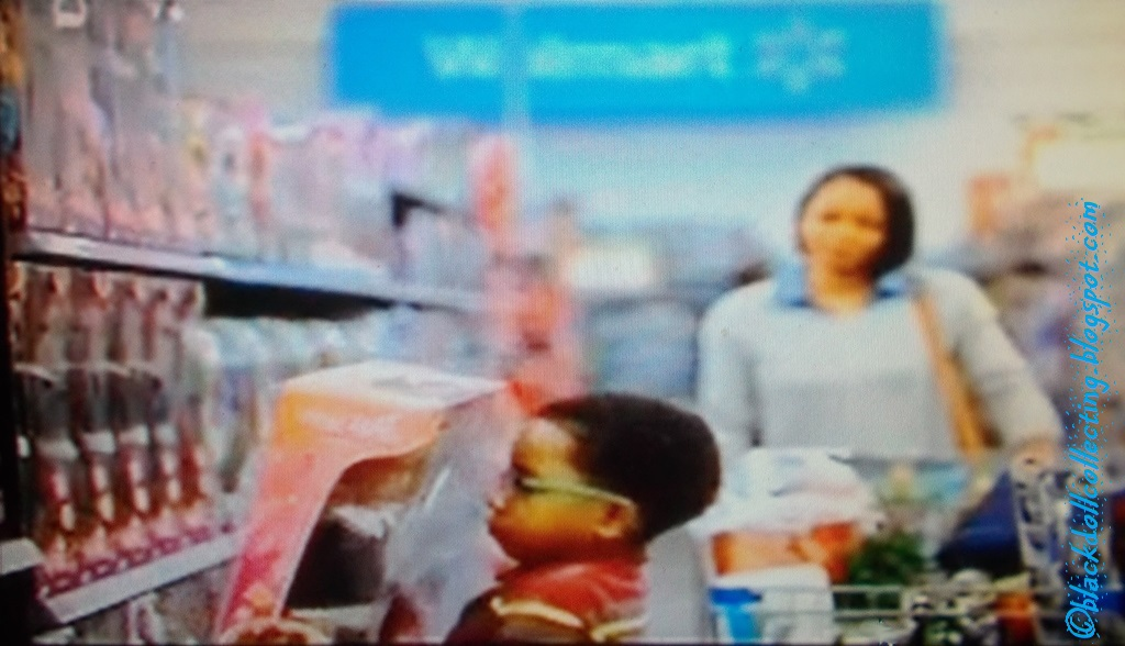 a little boy shops at walmart with mom in this walmart christmas commercial - Walmart Christmas Commercial