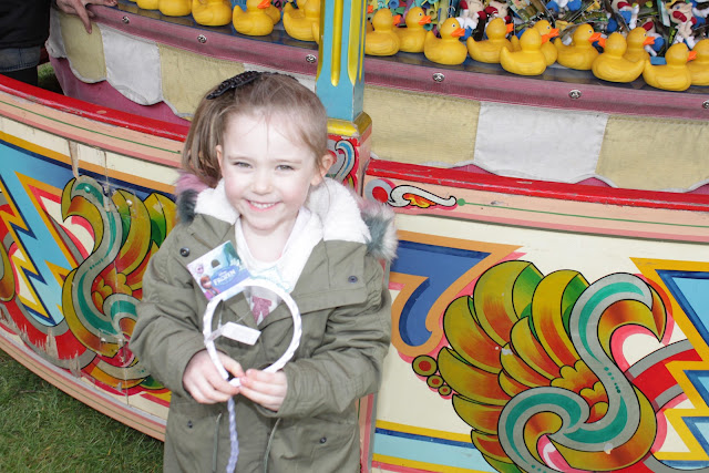 My niece holding the Disney Frozen prize she won from Carters Steam Fair hook a duck.