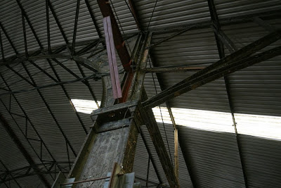Interior photograph showing the roof including steel beams and struts and a corrugated iron roof.