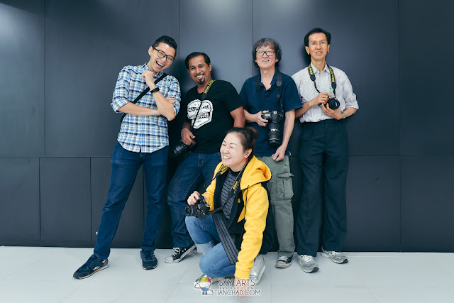 A group self-portrait with my Nikon team members after complete our shooting! Love the candid