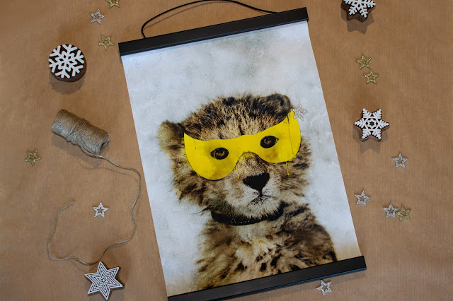 A painted print canvas of a leopard with a superhero mask with a black magnetic bar frame