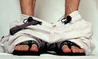 """Caught with your pants down i.e. """"leaving a dump""""."""