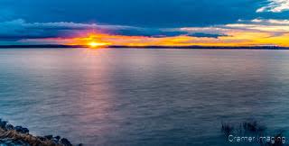 Cramer Imaging's fine art landscape photograph of American Falls reservoir at sunset with a sunburst in Idaho