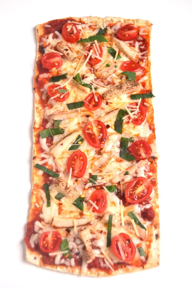 Chicken Parmesan Pizza has all the flavor of your favorite chicken Parmesan on a thin, crispy pizza crust along with fresh basil, tomatoes and melted cheese. The best part: it is ready in just 15 minutes! www.nutritionistreviews.com