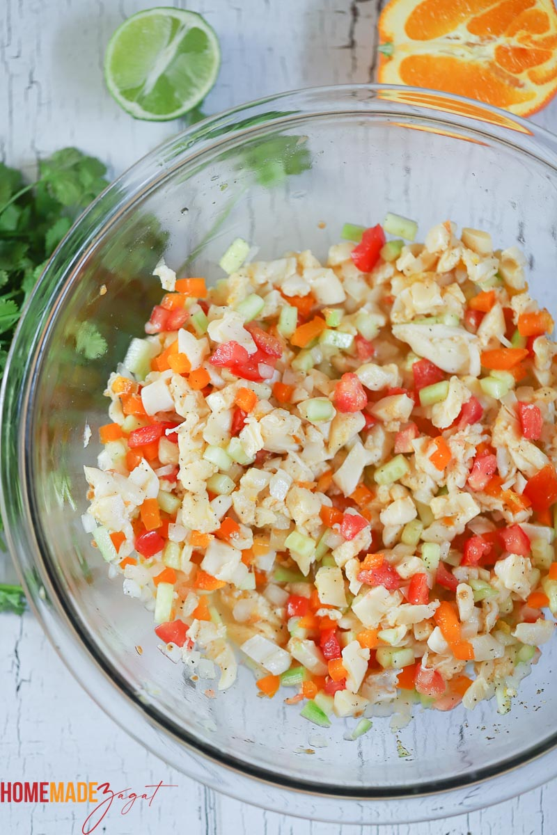 Added citrus juices and conch with vegetables