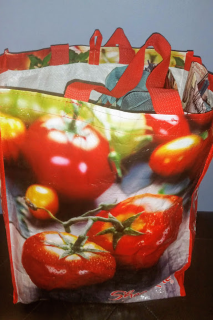 Image of reusable shopping bag with tomatoes and other produce print and Shop Rite logo