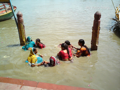 Devotees taking a dip at the Yamuna River Ghat, Mathura