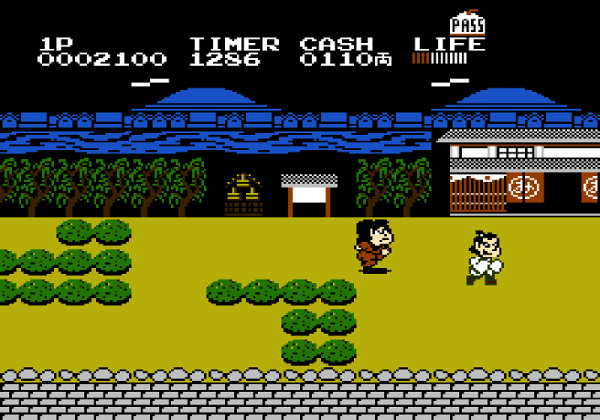 A screenshot of the game where Goemon is running through the streets of a village.