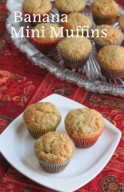 Food Lust People Love: Sweet fluffy bites, perfect with a glass of cold milk or a cup of hot tea, your family will eat these banana mini muffins in a flash. These little guys are a great recipe for using up that last banana that always languishes at the end of a bunch, brown and speckled but oh so sweet.