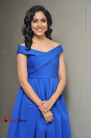 Actress Ritu Varma Pos in Blue Short Dress at Keshava Telugu Movie Audio Launch .COM 0008.jpg