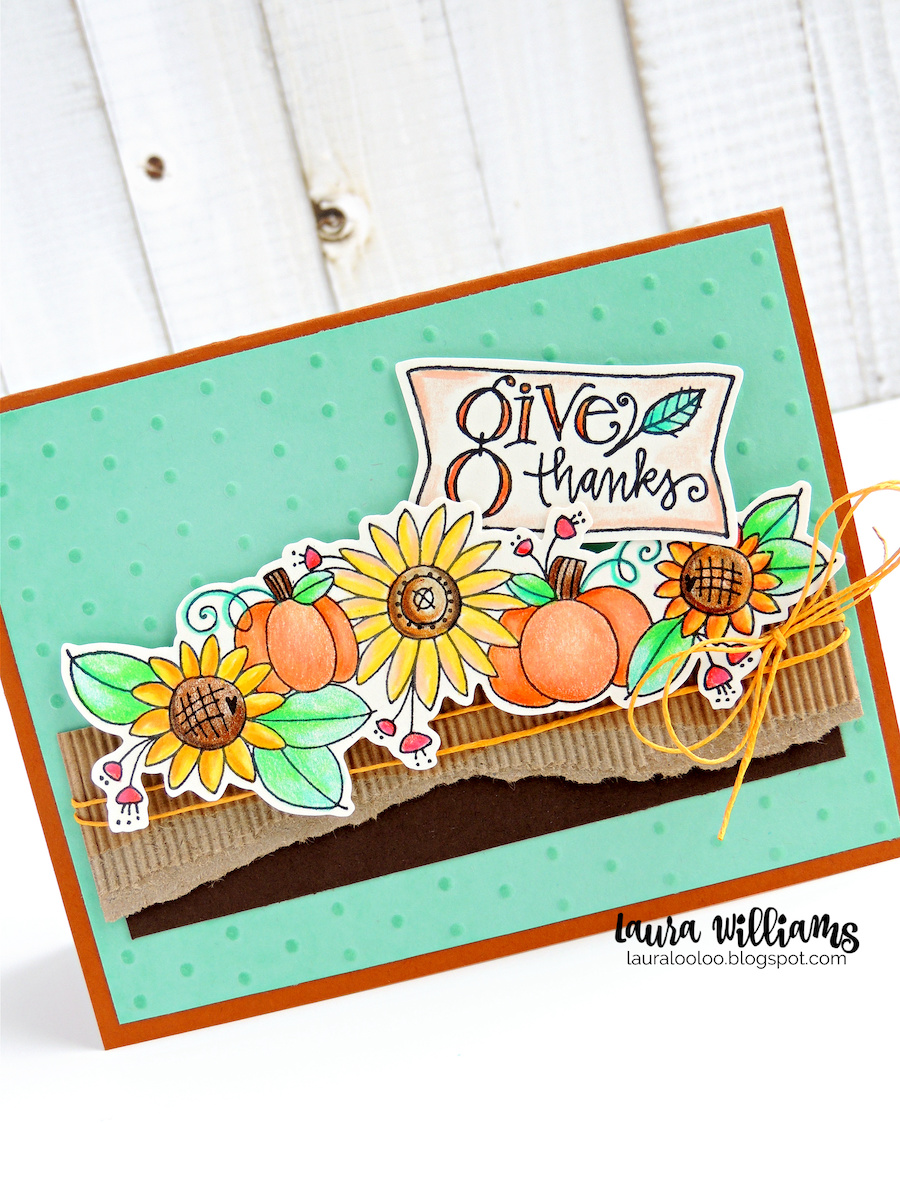 is is a handmade autumn card with an aqua background. The focal point is a spray of sunflowers and pumpkins, with greenery. It was colored in warm colors with colored pencils. There is a notched tag that says Give Thanks, tucked into the plants, making it a perfect fall thank you card or Thanksgiving card. The sunflowers and pumpkins are resting on a strip of Kraft colored corrugated stock, and dark brown cardstock, wrapped with yellow twine. The stamps are from Impression Obsession.