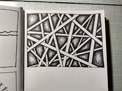 A pen and ink drawing of lines in a sketchbook.