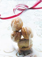 French macarons in a clear bag with red ribbon