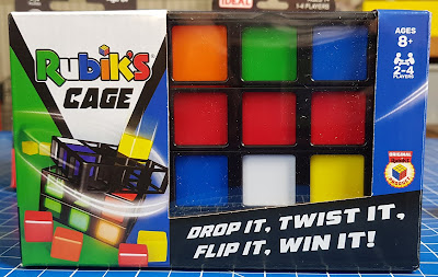 Rubik's Cage Review pack shot showing a cube of coloured blocks 3 x 3 x 3 in a black plastic cage