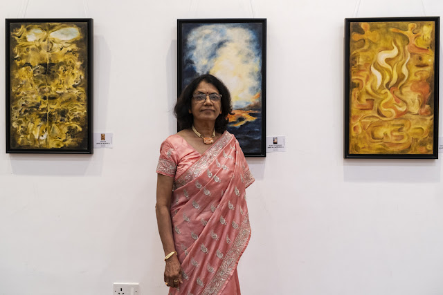 Artist Nirmal Pathare with her paintings