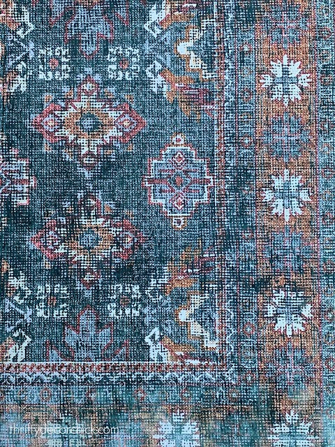 dark blue vintage navy rug with accent colors