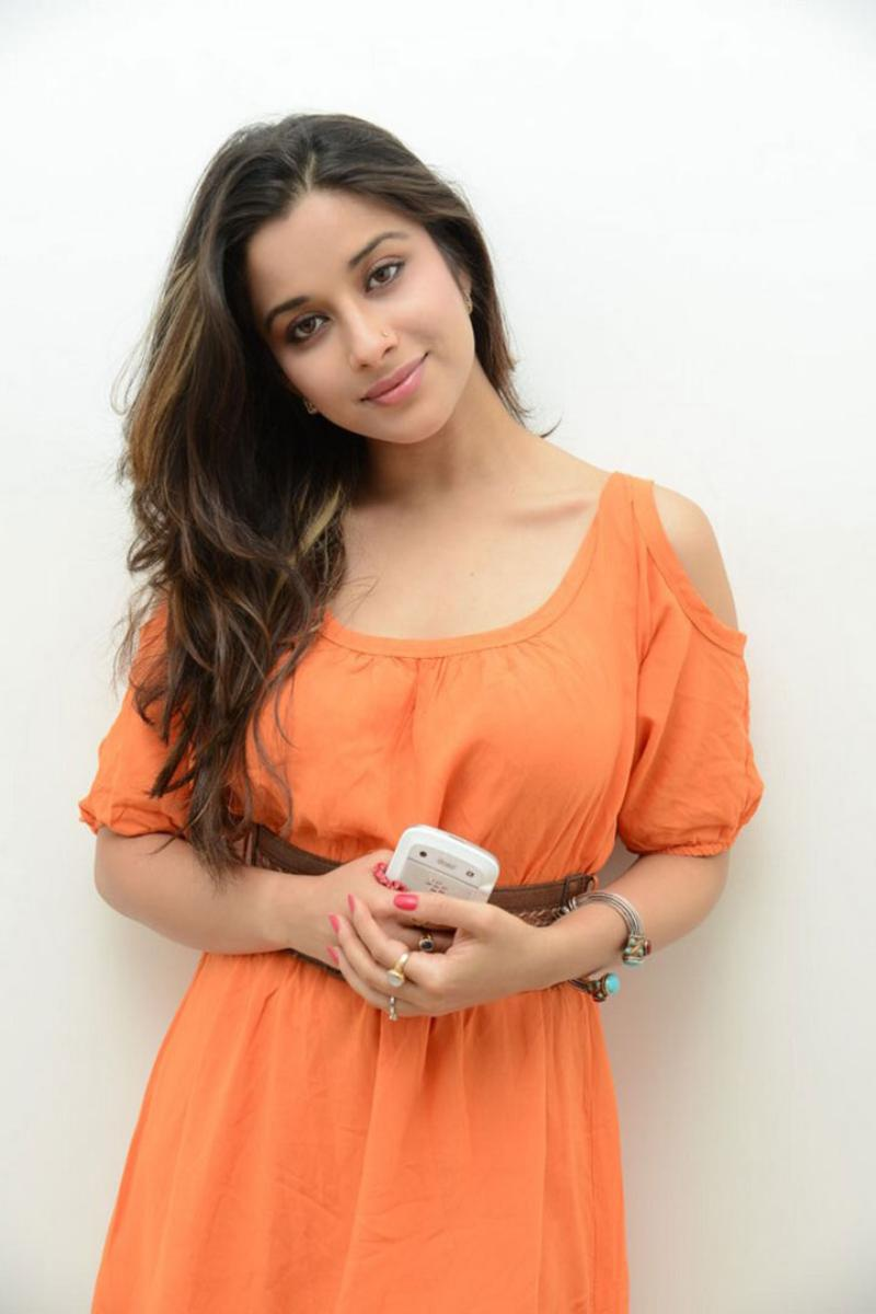Madhurima Nyra Banerjee spicy pics, Madhurima Nyra Banerjee in orange dress