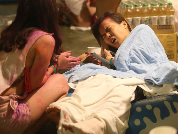 Injured victims are treated after an accidental explosion during a music concert at the Formosa Water Park in New Taipei City, Taiwan, Saturday, June 27, 2015.