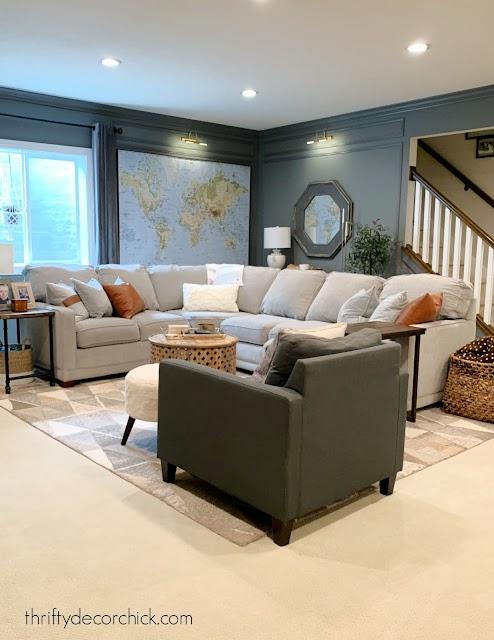 Cozy basement family room with dark gray walls