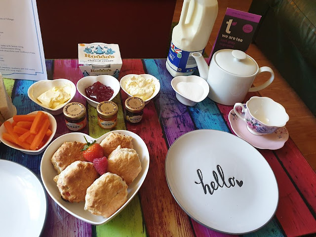 Scones, jams and cream, afternoon tea.