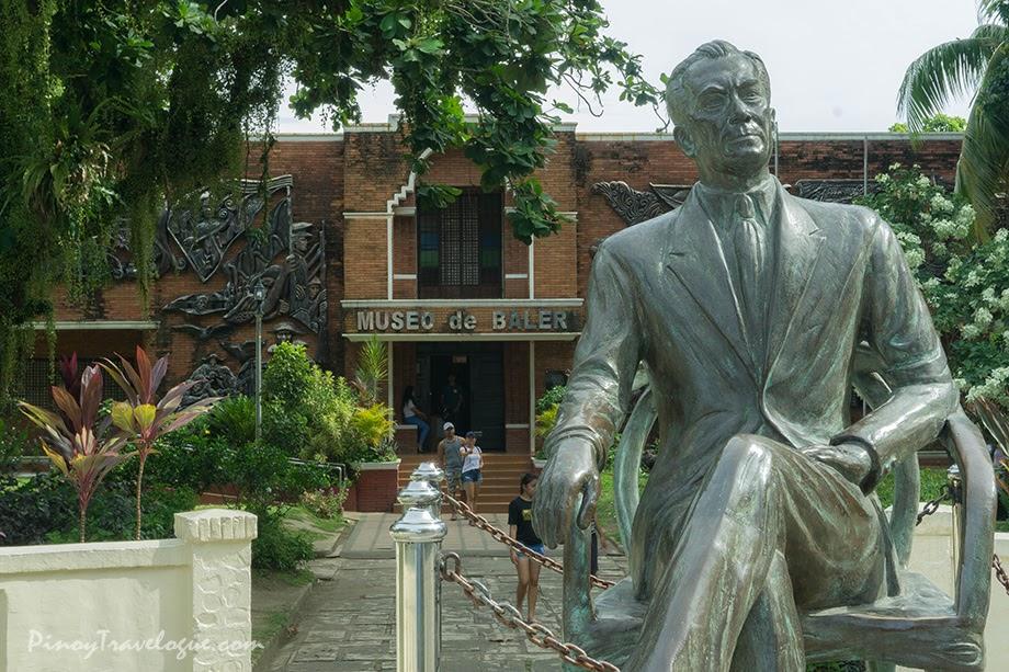 Manuel Quezon's statue and Museo de Baler's facade