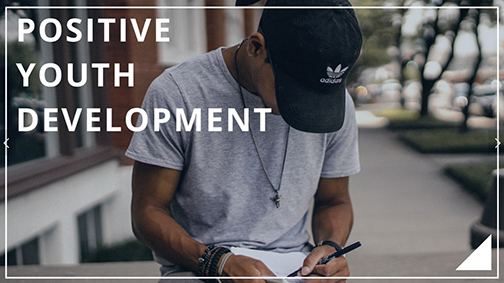 Photo of a young man writing in a notebook.  Text: Positive Youth Development
