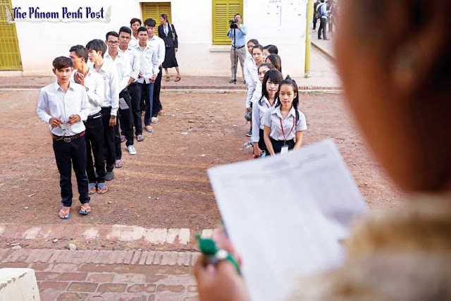 Students line up before taking their Grade-12 exams at Sisowath High School in Phnom Penh earlier this month. Pha Lina