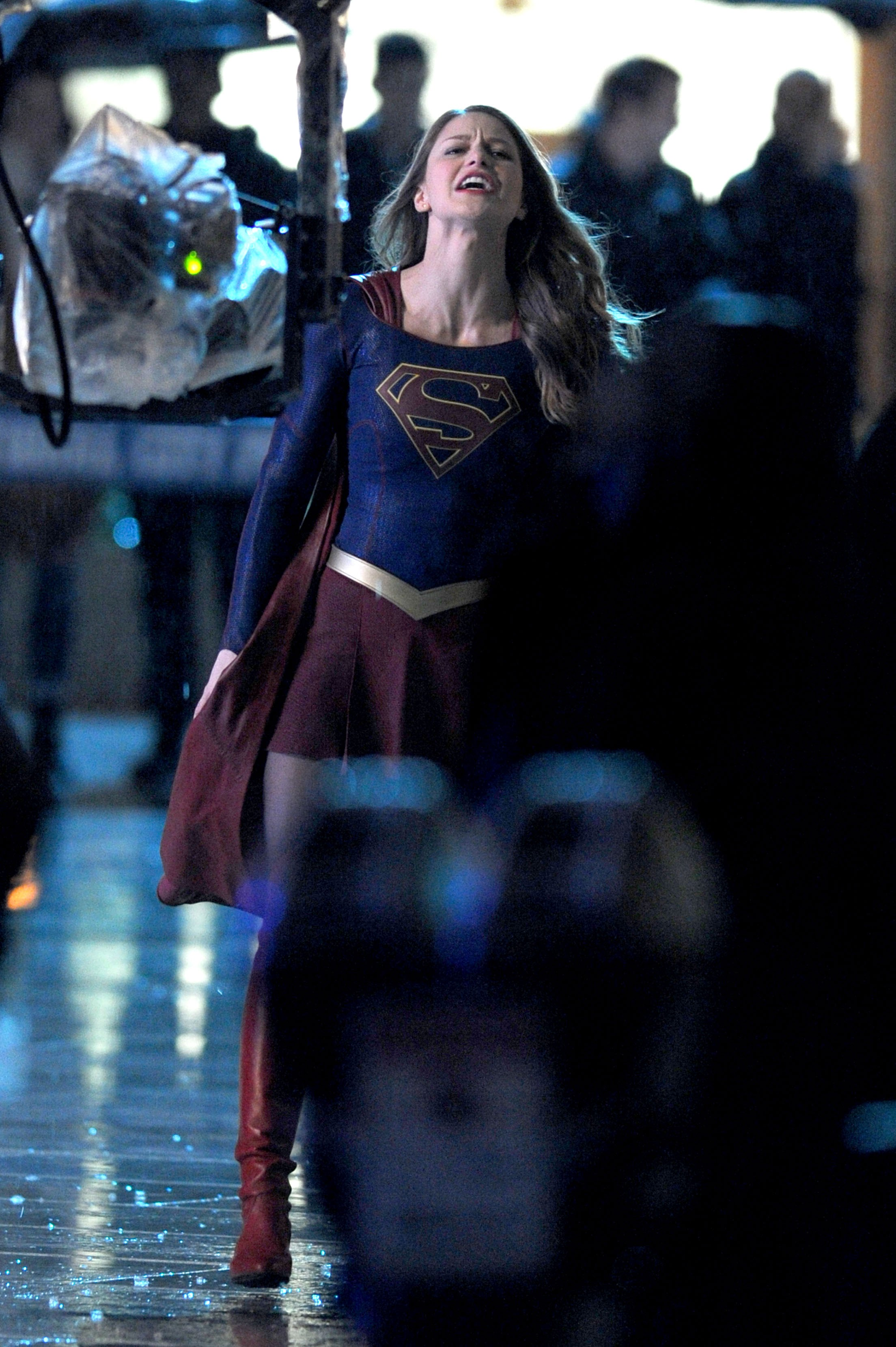 Melissa Benoist the Supergirl caught in cold rain falls in the night time season 2 location