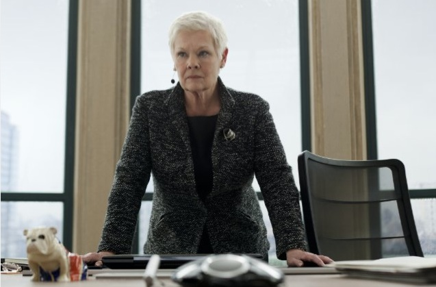 Judi Dench as M behind her desk