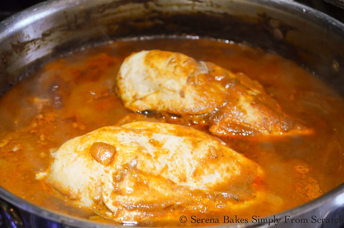 Cooked Chicken Breast in Red Enchilada Sauce.