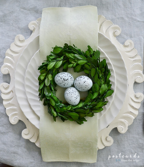 place setting with boxwood wreath and ceramic bird eggs