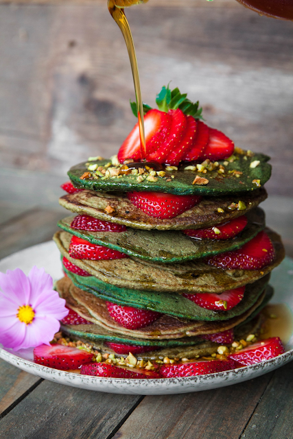 Photo of pancake stack with strawberries and flowers by Gianna Ciaramello