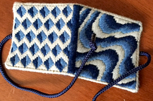 square folded needle book, canvas work embroidery in blues and cream