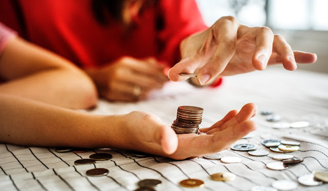 Image: Person Holding Coins, by RawPixel.com on Pexels