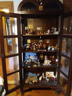 dolls house in a china cabinet