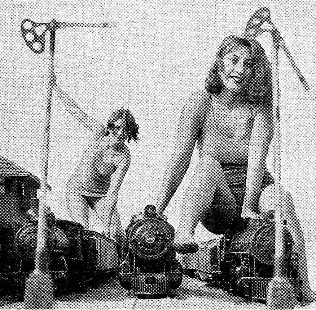 a 1930 outdoor photo-shoot for a magazine, with beach girls on miniature trains