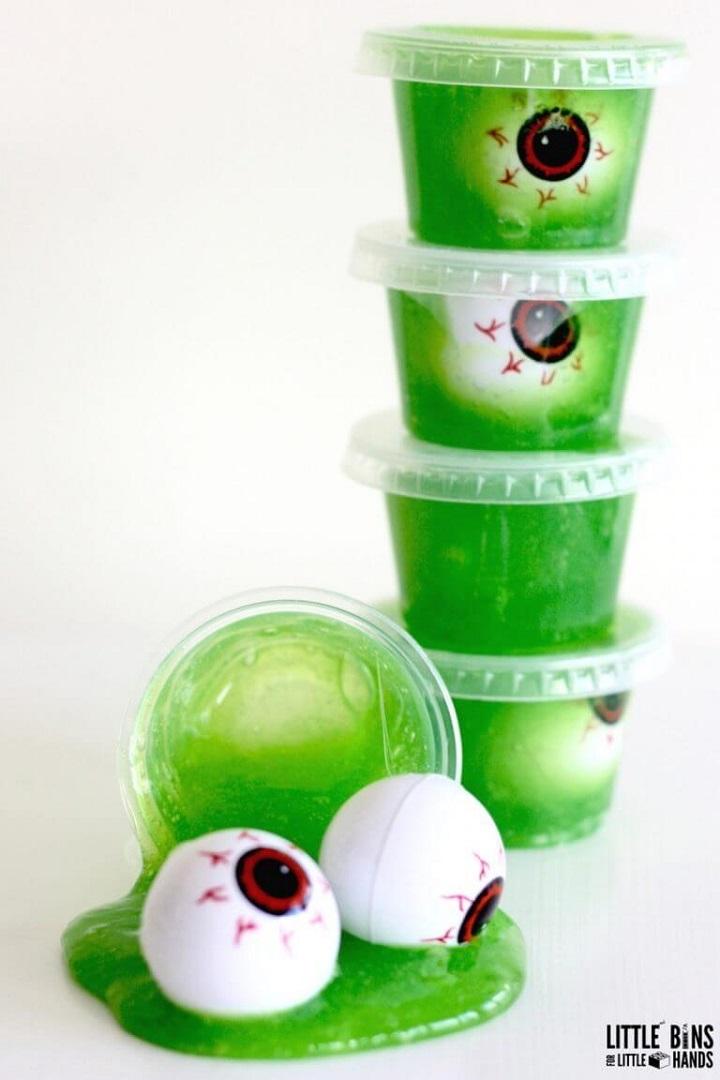 green halloween slime with eyeballs