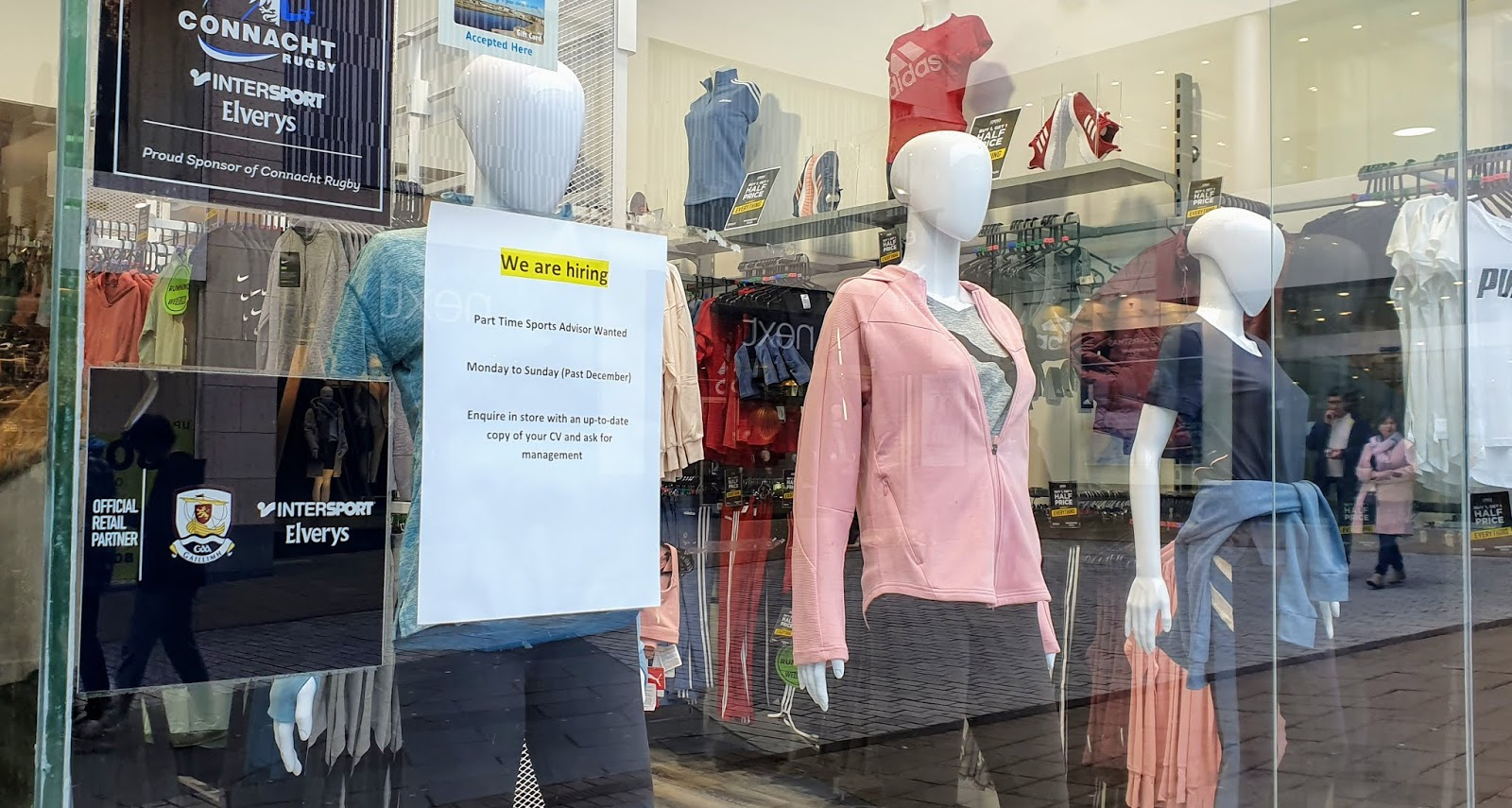 Shop window with three bald, sporty mannequins on display - also a sign about Elverys Intersport Galway, proud sponsors of Connacht Rubgy in 2019