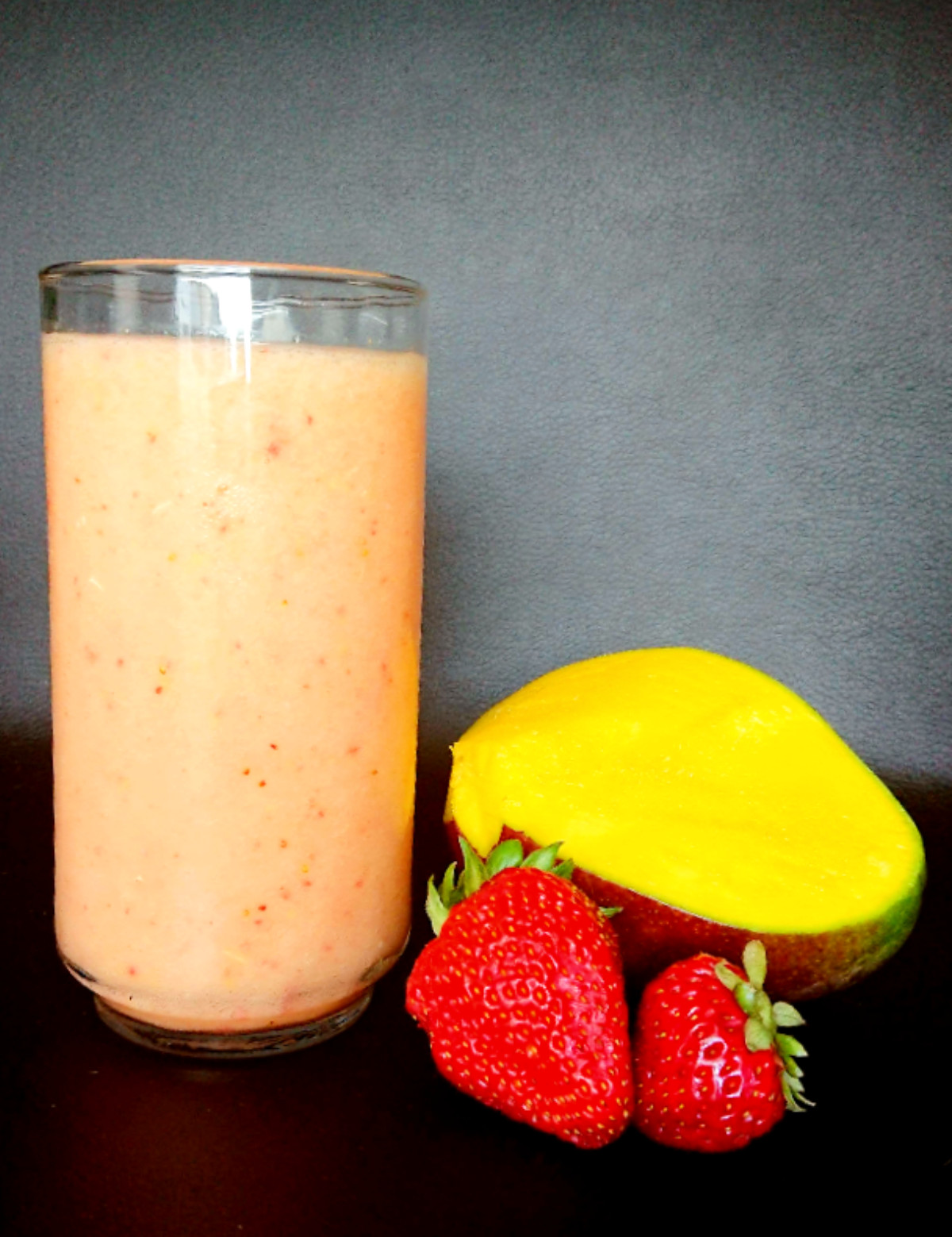 Fruit mocktail in a glass with mango and strawberries