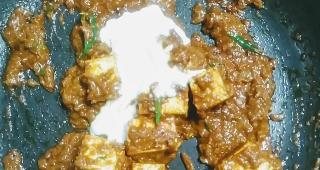 Pouring fresh cream into the paneer butter masala recipe