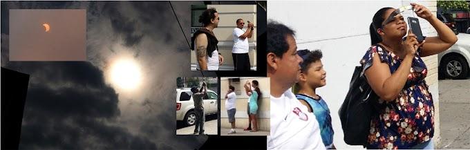 Dominicanos observan eclipse en Nueva York desde calles, ventanas, azoteas y parques