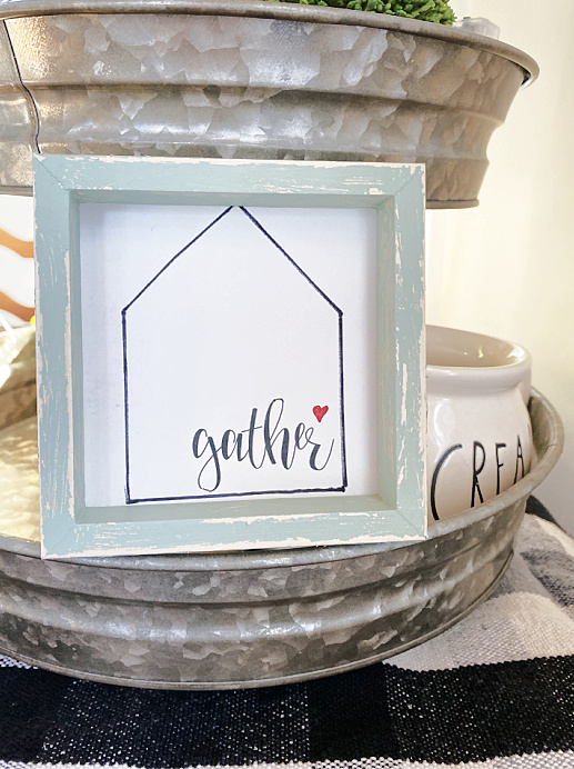 gather sign in a tiered tray